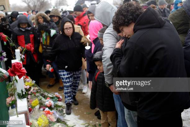 Family members and friends mourn the lost of Vicente Juarez as they attend a prayer vigil outside Henry Pratt Company on February 17 2019 in Aurora...