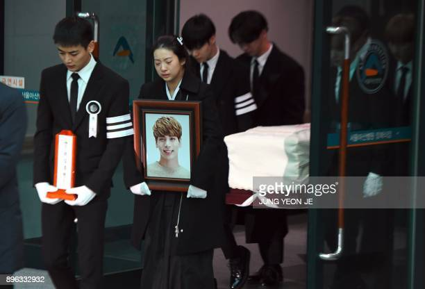 Family members and friends of late SHINee singer Kim JongHyun carry out his coffin during a funeral at a hospital in Seoul on December 21 2017 Kim a...