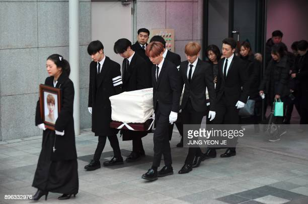 TOPSHOT Family members and friends of late SHINee singer Kim JongHyun carry out his coffin during a funeral at a hospital in Seoul on December 21...