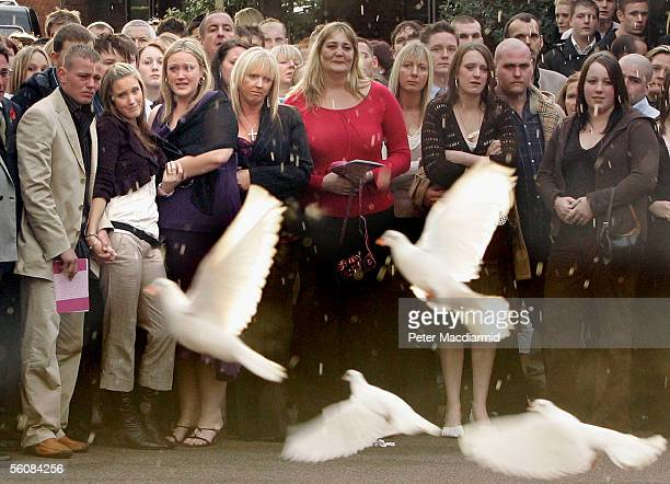 Family members and friends of murdered model Sally Anne Bowman watch as white doves are released after her funeral in Croydon on November 4 2005 in...