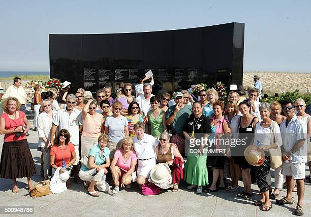 Family members and friends of those who perished on TWA Flight 800 pose for a photo in front of the memorial 17 July 2006 at Smith Point Park in...