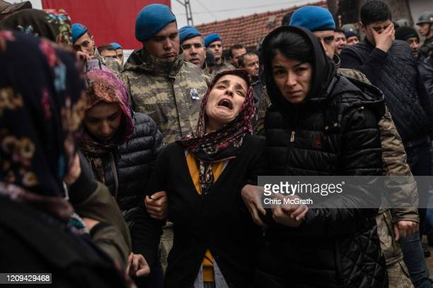 Family members and friends of Turkish soldier Emin Yildirim who was killed in an airstrike in Idlib on February 27 grieve during his funeral ceremony...