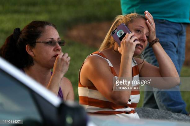 Family members and friends wait for their loved ones at a staging area after a shooting on the campus of University of North Carolina Charlotte in...