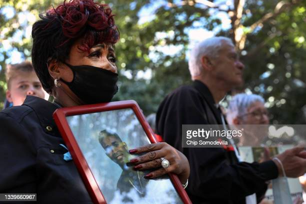 Family members and loved ones of victims attend the annual 9/11 Commemoration Ceremony at the National 9/11 Memorial and Museum on September 11, 2021...