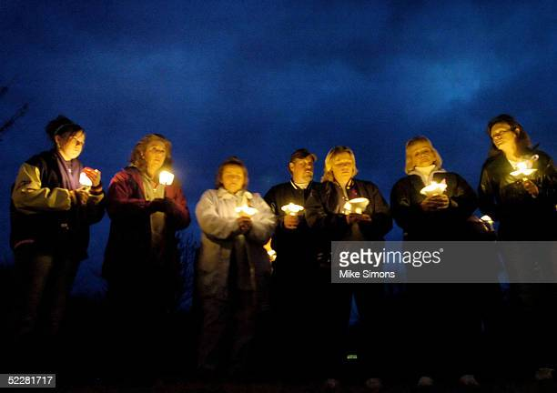 Family members and members of the community take part in a vigil for Jessica Marie Lunsford March 5 2005 in Roachester Ohio Lunsford's mom and much...