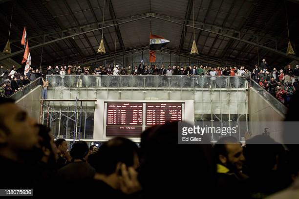 Family members and mourners gather at Cairo's railway station as they receive the bodies of 74 football fans who were killed during clashes between...