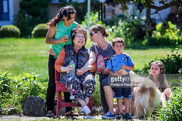 Family members and neighbors comfort a woman as she cries after losing the house she lived in on Crestview Drive in South Portland to fire Friday...