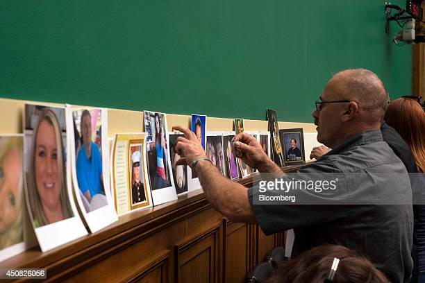 Family members and people who lost loved ones due to accidents caused by a defective ignition switch in General Motors Co cars place photos in a...