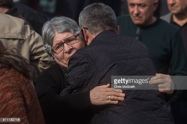 Family members and relatives grieve for victims of a car bombing outside the forensic morgue on February 18 2016 in Ankara Turkey At least 28 people...