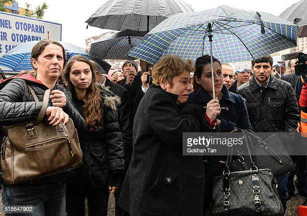 Family members and relatives grieve for victims of a car bombing outside the forensic morgue on March 14 2016 in Ankara Turkey At least 37 people...
