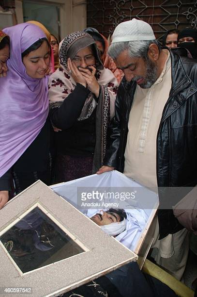 Family members and relatives mourn over the death of a student killed in a Taliban attack at an armyrun school prior to his burial in Peshawar...
