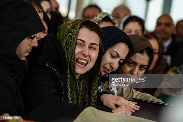 Family members and relatives of car bombing victim Hamide Sibel Cetinkaya mourn over a coffin during the funeral ceremony in a mosque on March 14...