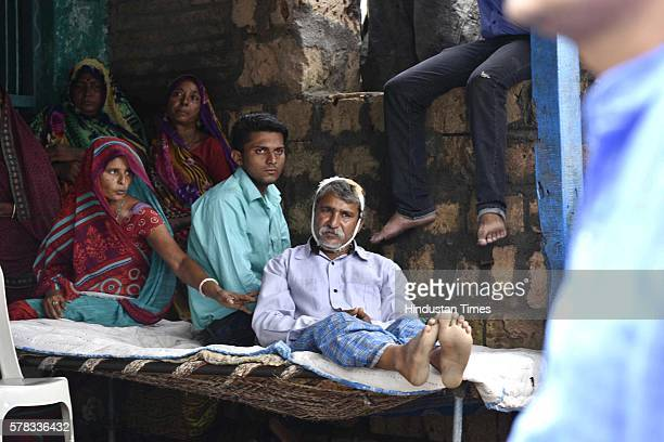 Family members and relatives of Dalit victims families who were brutally assaulted by selfstyled 'cow protectors' last week on July 21 2016 in Una...
