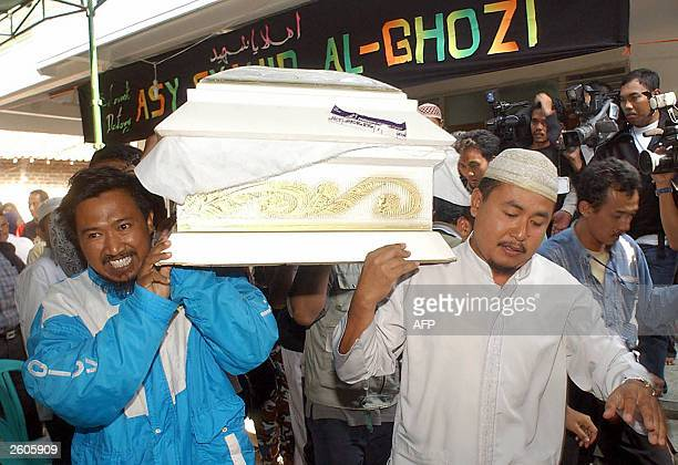 Family members and relatives of Fathur Rohman alGhozi's village carry the Jemaah Islamiyah bombmakers coffin during the funeral in Madiun 17 October...