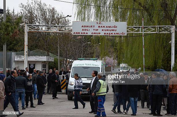 Family members and relatives of the victims of a car bombing wait outside the forensic morgue on March 14 2016 in Ankara Turkey At least 37 people...