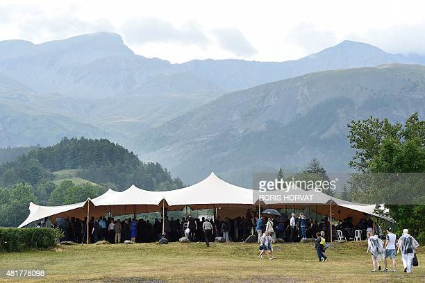 Family members and relatives of the victims of the crash of the Germanwings plane gather during a ceremony on July 24 2015 in Le Vernet southern...
