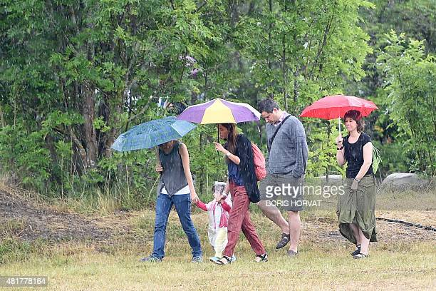 Family members and relatives of the victims of the crash of the Germanwings plane arrive for a ceremony on July 24 2015 in Le Vernet southern France...