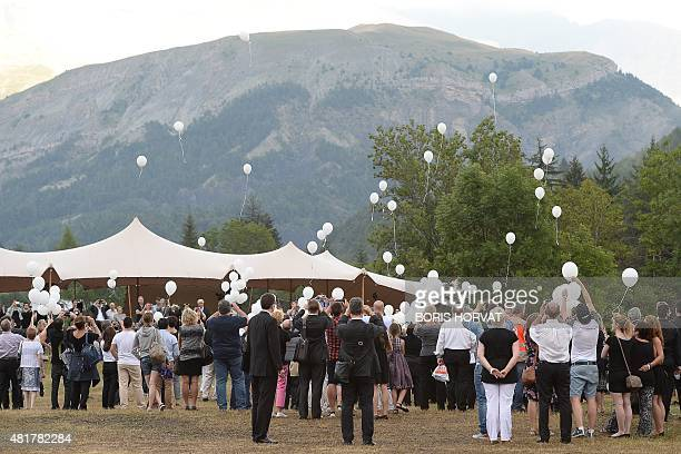 Family members and relatives of the victims of the crash of the Germanwings plane throw 149 white balloons during a ceremony on July 24 2015 in Le...