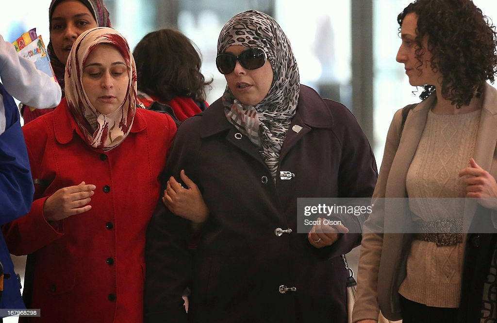 Family members and supporters of 18-year-old Abdella Ahmad Tounisi, including his mother Seham (C) and attorney Molly Armour (R), leave the Dirksen Federal Building following a court hearing for Tounisi on May 3, 2013 in Chicago, Illinois. A judge today overturned yesterday's decision by Judge Daniel Martin to release Tounisi on bond. Tounisi is accused of trying to fly to Turkey to join up with an al-Qaida group to fight in Syria. He has also been accused of plotting to bomb a Chicago bar last year.