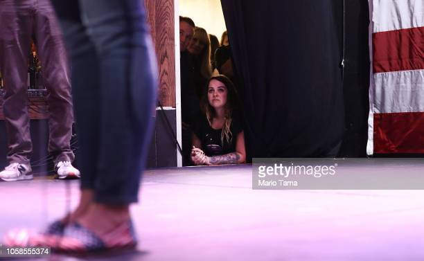 Family members and supporters watch from backstage as Democratic Congressional candidate Katie Hill speaks to supporters at her election night party...
