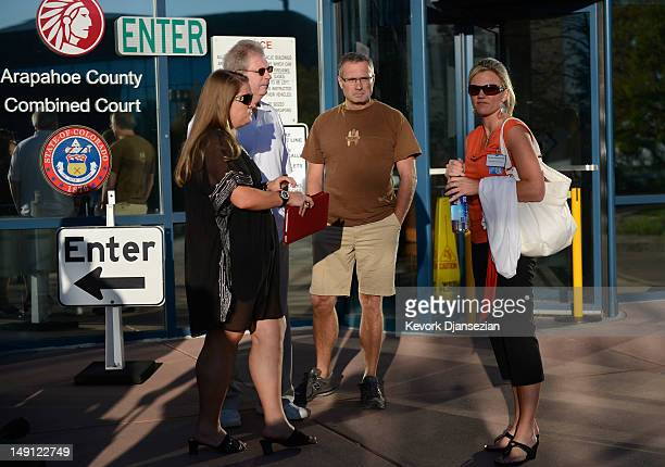 Family members and their representatives wait to enter the Arapahoe County Courthouse for the first court hearing for alleged Century 16 movie...