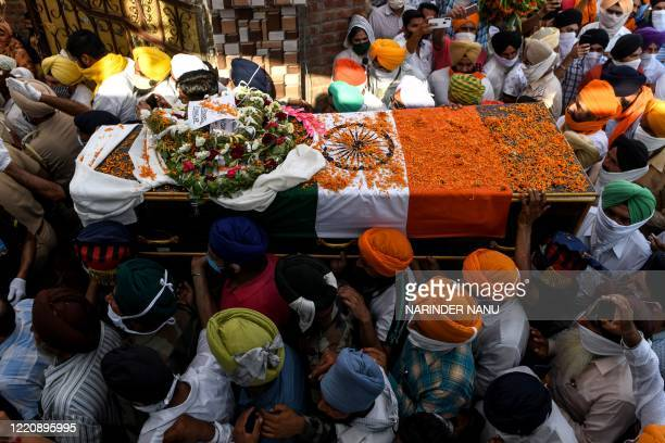 Family members and villagers carry the coffin of soldier Satnam Singh who was was killed in a recent clash with Chinese forces in the Galwan valley...