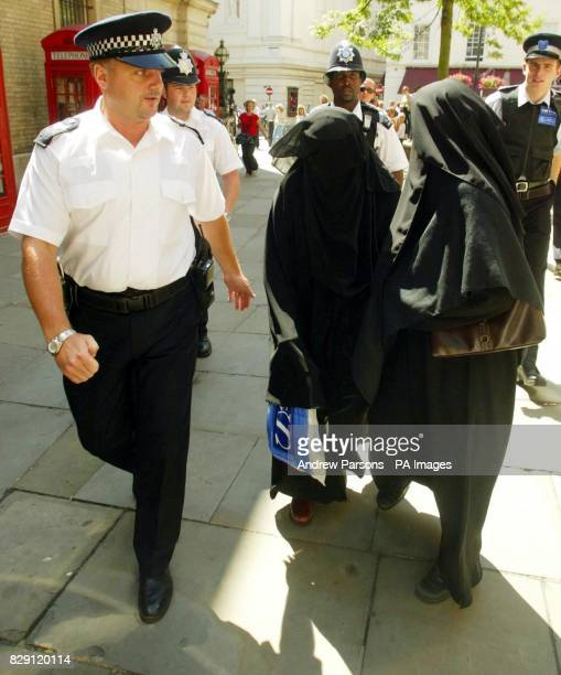 Family members are escorted by police officers as they leave Bow Street Magistrates Court after Babar Ahmad of Fountain Road Tooting south London...