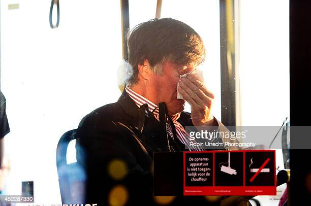 Family members are leaving Schiphol airport in a provided bus on July 17 2014 in Amsterdam Netherlands Malaysia Airlines flight MH17 travelling from...