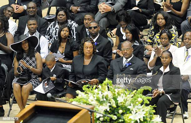 Family members attend a funeral service for former NFL quarterback Steve McNair on July 11 2009 in Hattiesburg Mississippi Mechelle McNair wife of...