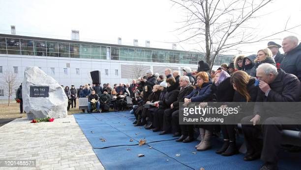 Family members attend the inauguration ceremony of the memorial at the site for the future park that will commemorate 176 victims of the Ukraine...