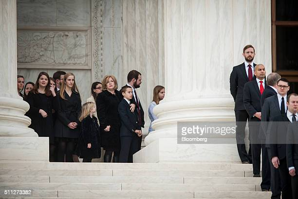 Family members await the arrival of the casket of associate Justice Antonin Scalia at the Supreme Court of the United States in Washington DC US on...