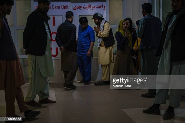 Family members beg officials to be reunited with their loved ones, after casualties were rushed to local hospitals after a recent attack on Kabul...