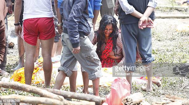 Family members broke down in tears during mass cremations of earthquake victims at Pashupati Cremation Ghat Ground on April 27 2015 in Kathmandu...