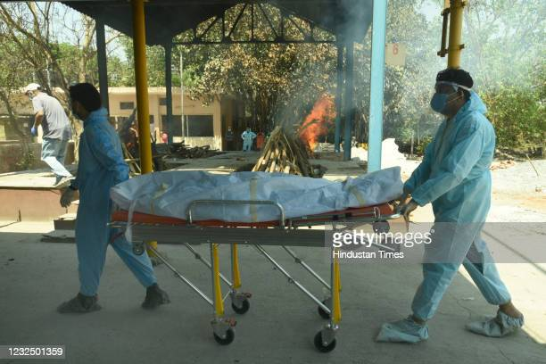 Family members carry the body of a COVID-19 victim for cremation, at a crematorium, in Sector 94, on April 24, 2021 in Noida, India.