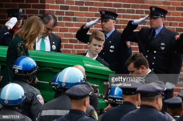 Family members carry the casket of 6yearold Devin Suau who succumbed to a battle with brain cancer one week shy of his 7th birthday at St Anselm...