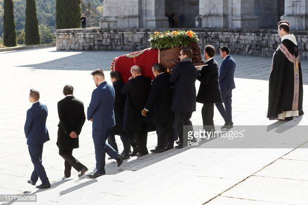 Family members carry the coffin of Francisco Franco out of the basilica of the Valley of the Fallen mausoleum during the exhumation of the Spanish...