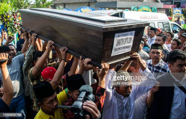 Family members carry the coffin of Jannatun Cintya Dewi who was a passenger on the illfated Lion Air flight JT 610 which crashed on October 29 during...