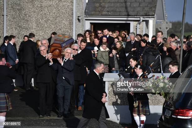 Family members carry the late Dolores O'Riordan from St Ailbe's Church Ballybricken on January 23 2018 in Limerick Ireland The Cranberries singer...