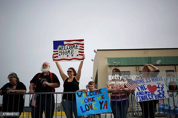 Family members cheer as a charter flight carrying troops from the U.S. Army's Battery B, 2nd Battalion, 44th Air Defense Artillery Regiment, 101st...