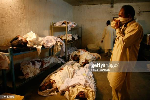 Family members come to identify the dead at the Edhi Morgue October 19 2007 in Karachi Pakistan A suicide bombing killed at least 136 people in an...