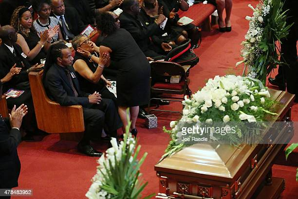 Family members comfort each other during the funeral of Ethel Lance who was one of nine victims of a mass shooting at the Emanuel African Methodist...