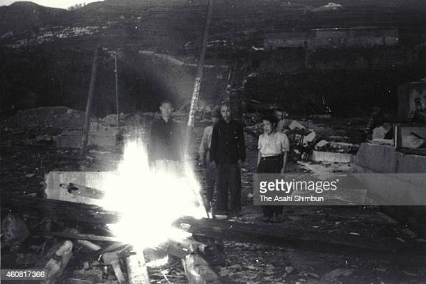 Family members cremate a body of the atomic bomb circa September 1945 in Nagasaki Japan The world's first atomic bomb was dropped on Hiroshima on...