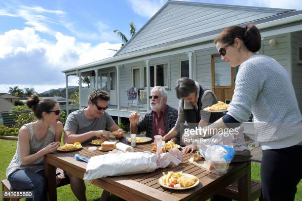 Family members eats fish and chips together