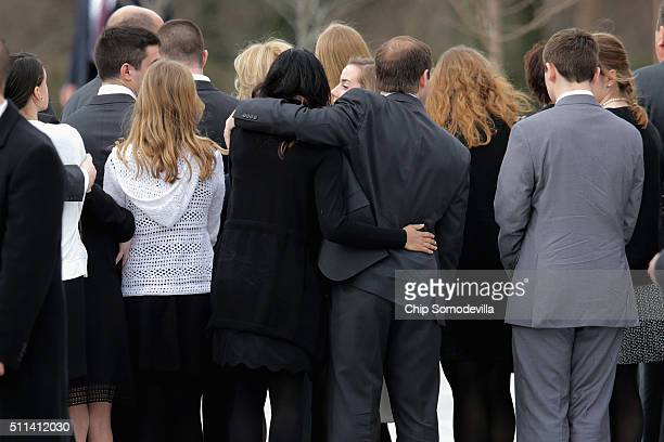 Family members embrace as they watch Associate Justice Antonin Scalia's flagcovered casket being taken into the Basilica of the National Shrine of...
