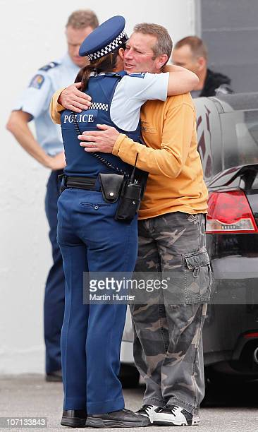 Family members embrace before a visit by New Zealand Prime Minister John Key on November 25 2010 in Greymouth New Zealand Families were informed...