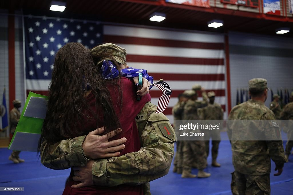 Family members embrace following a homecoming ceremony for members of the U.S. Army's 3rd Brigade Combat Team, 1st Infantry Division in the Natcher Physical Fitness Center on Fort Knox on February 27, 2014 in Fort Knox, Kentucky. About 100 soldiers returned to Fort Knox after a nine-month combat deployment conducting village stability operations and working alongside Afghan military and police forces.