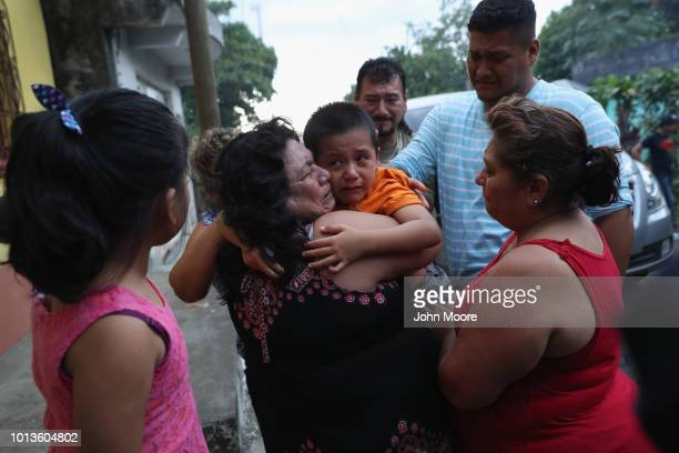 Family members embrace Leo Jeancarlo de Leon after he returned home froam the United States on August 8 2018 near San Marcos Guatemala He had been...