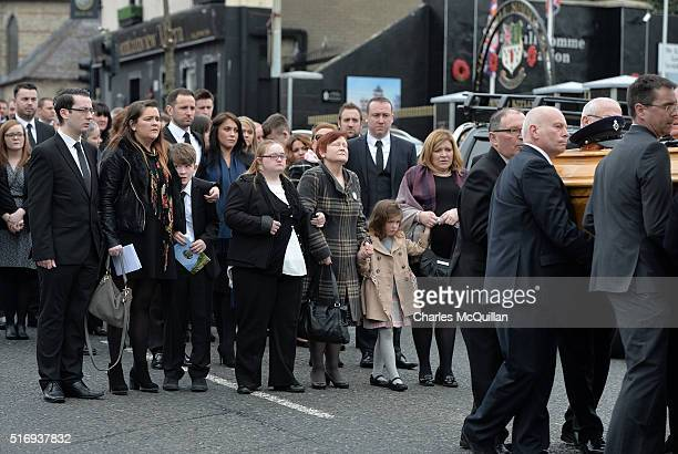 Family members follow the remains of murdered prison officer Adrian Ismay as his funeral takes place on March 22 2016 in Belfast Northern Ireland Mr...