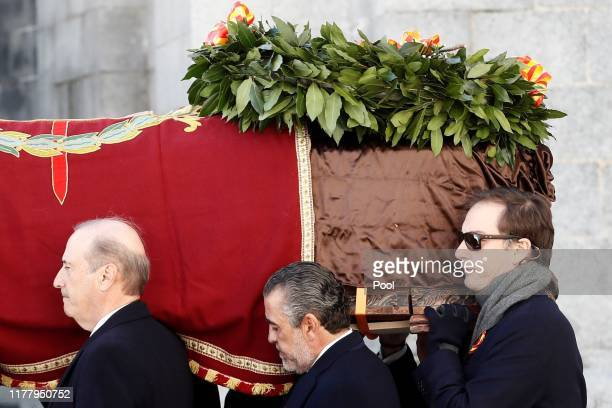 Family members Francis Franco and Jaime MartínezBordiú carry the coffin of Francisco Franco out of the basilica of the Valley of the Fallen mausoleum...