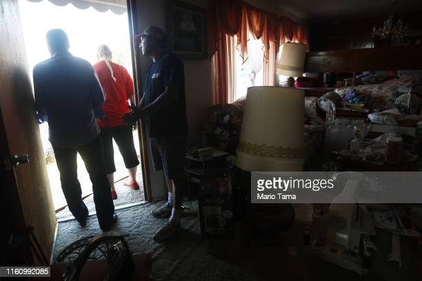 Family members gather while packing the Eldridge family home which has been deemed uninhabitable due to structural damage from the recent 71...